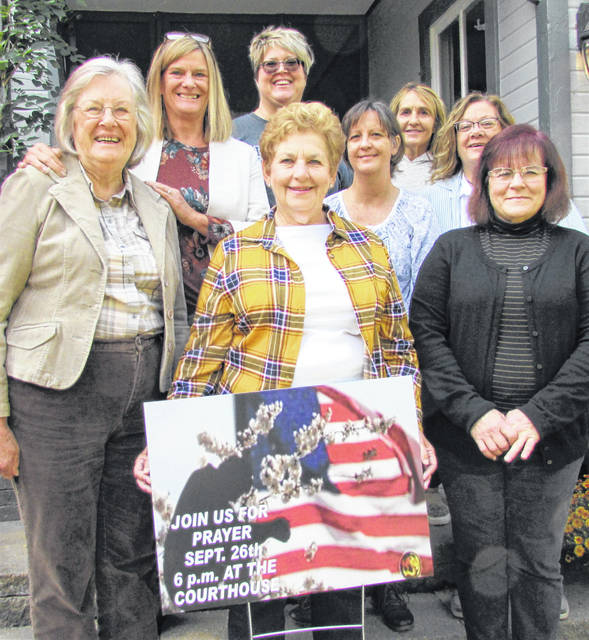 """Members of the Good News Gathering's ladies group """"Better Together in Christ,"""" shown from left, are Pat Fields, Letty Allen, Holly Braden, Elora Fleming (holding the sign), Lisa Kidder, Melissa Elmore, Theresa Raisch and Cathy Siefer."""