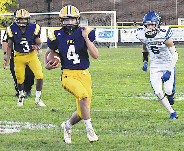 McClain's Trevor Stonerock finds some running room Friday night at McClain High School where the Tigers took on the Chillicothe Cavaliers in Frontier Athletic Conference action and lost by a score of 35-7.