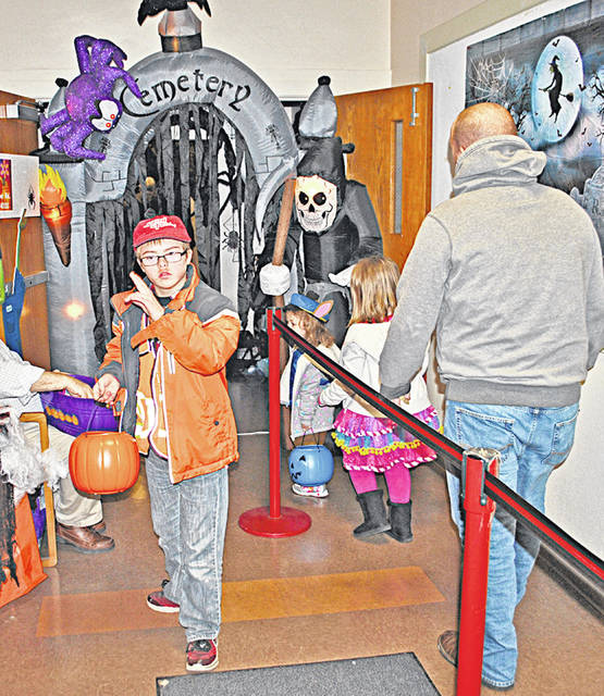 In a scene from 2016, some of the hundreds of kids and adults who stopped by The Times-Gazette's offices to visit a haunted house arer pictured. Then-13-year-old Leesburg resident Christian White (center) is shown exiting the haunted house.