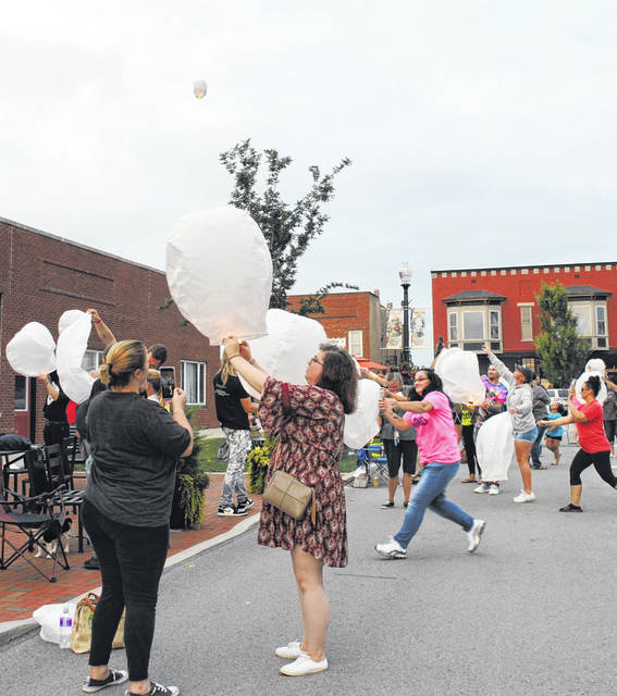 Following Hope for Highland and REACH for Tomorrow's event in honor of National Overdose Awareness Day, the event's attendees release lanterns in memory of those who fatally overdosed.