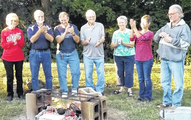 Pictured, from left, are Bev Mayo, Dan Mayo, Chuck Johnson, Wayne Waggoner, Martha Waggoner, Terese Hamilton and Scott Kirshner during a mortgage burning at the New Vienna Community Church.