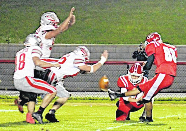 This blocked punt was returned by East Clinton 82 yards for a touchdown Friday night at Richards Memorial Field in Hillsboro.