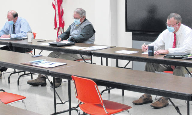 From left, commissioners David Daniels, Jeff Duncan and Terry Britton are shown at Wednesday's weekly commissioners meeting.