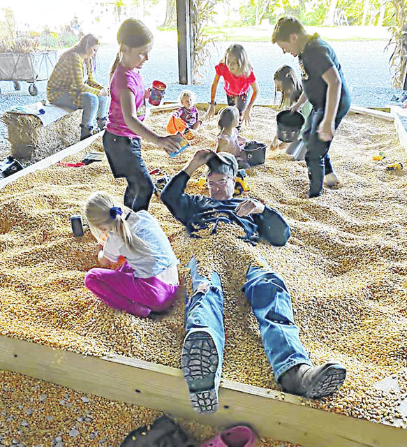 Kids and adults alike enjoy the corn pit at the Ballentine Corn Maze south of Hillsboro.