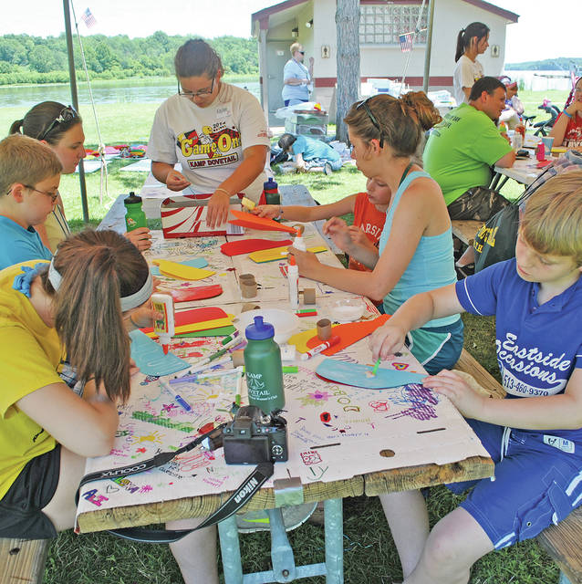 Campers and staff members work on crafts during a past KAMP Dovetail at Rocky Fork State Park.
