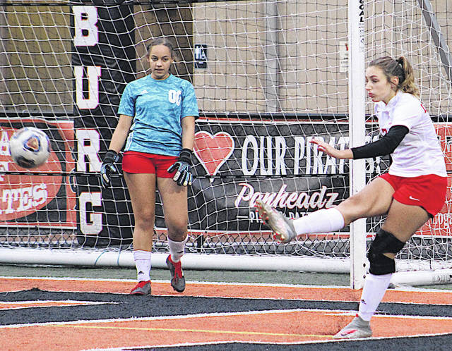 Fairfield senior Morgan Richmond boots the ball away from her goal during Tuesday's district semifinal loss to Wheelersburg. Looking on is Lady Lion goalkeeper Alayna McIntosh.