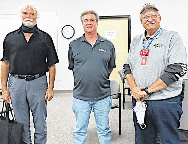 Highland Amateur Radio Association President Jeff Collins (center) is pictured with Michael Kalter and Scott Yonally.