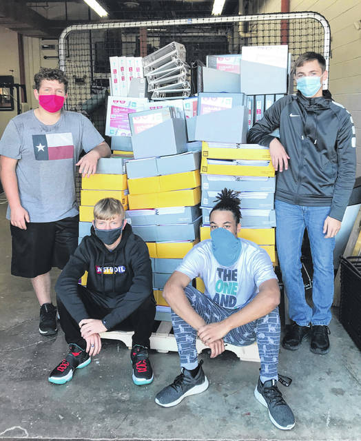 The Bright Local Schools recently received a large donation from the Hillsboro Walmart that included 1.5-inch binders and notebooks with an approximate value of $2,000. Whiteoak High School students are pictured with the supplies.