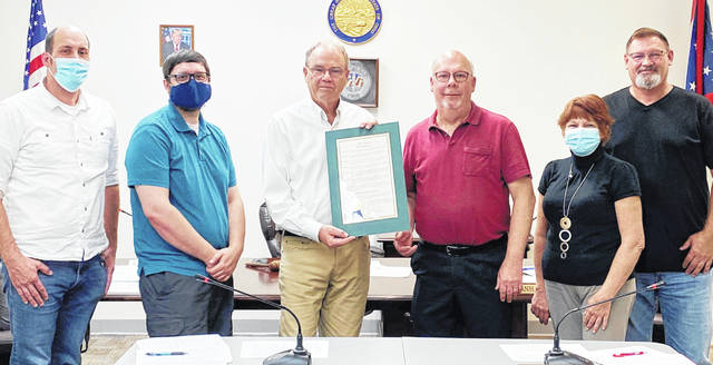 Keith Hart, owner and operator of Robbins Village Florist, was honored with a proclamation from Greenfield Village Council at Monday's meeting for his 40 years of service to the community. Pictured (l-r) are council members Eric Borsini, Kyle Barr and Phil Clyburn; Hart; and council members Brenda Losey and Mark Branham.