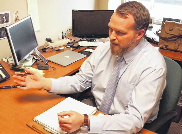 In a scene from a past interview, Highland County Health Commissioner Jared Warner explains local public health issues.