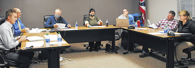 At its Thursday meeting, the Lynchburg-Clay Board of Education discusses how quarantine has affected the district's students. Pictured (from left) are superintendent Brett Justice, treasurer Richard Hawk, and board members Gary West, Bobbie Jo Ernst, Bret Malone, Brad Hess and Kristen Greenawalt.