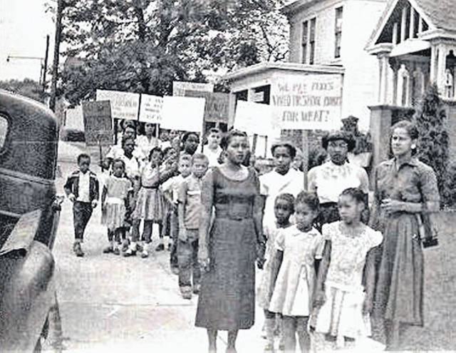 Some of the Hillsboro Marching Mothers and their children are shown during their daily walks in the 1950s walks to try and force desegregation of the city's schools.