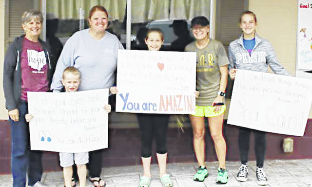 Seaman resident Casie Reed said that taking on the Goggins challenge, which pushes participants to run four miles every four hours during a 48-hour period, helped identify her support system. Pictured, from left, Hope House Director Julie Seaman, Kade, Jodi Seaman, Destiny, Casie Reed and Grace.