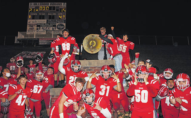 The Hillsboro Indians celebrate their 21-16 come-from-behind triumph over McClain in the 36th annual Rotary Bowl on Friday evening by ringing the Victory Bell at Richards Memorial Field in Hillsboro. Both teams entered the game without a win this season. The win was Hillsboro's fifth in a row in the series.