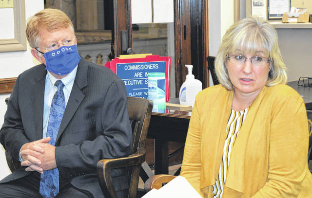 At the Clinton County Commissioners Office are, from left, Southern State Community College President Dr. Kevin Boys and Sonja Wilkin, program coordinator for the new SSCC College to Career Experience Program.