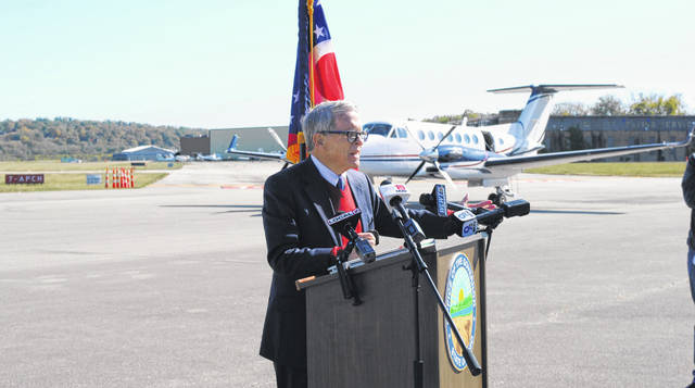 Ohio Gov. Mike DeWine addresses the increase in COVID-19 cases in Southern Ohio at his Friday afternoon press conference at the Cincinnati Municipal Airport's Lunken Field.