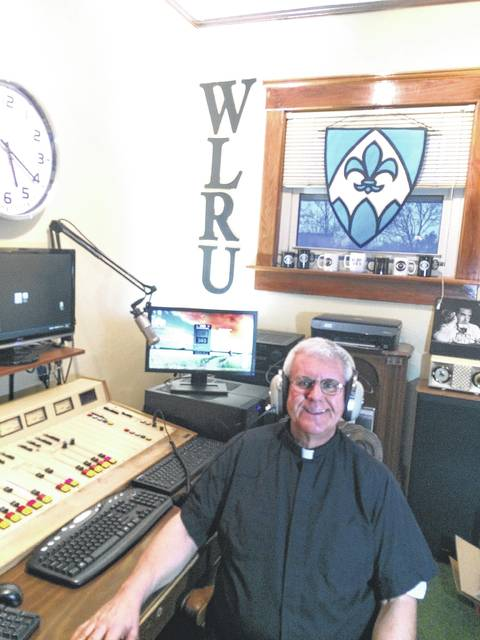 Father Mike Paraniuk is shown in the studio of WLRU, where he hosts programs designed to appeal to Christians beyond the Catholic faith.
