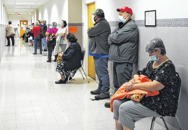 Highland County residents wait in line to vote at the Highland County Board of Elections office on Tuesday, the first day for early, in-person voting. Hillsboro resident David Grover told The Times-Gazette that he waited in line for almost three hours. Other community members told The Times-Gazette that the wait was worth it to exercise their right to vote.