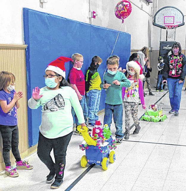 Students of Buckskin teachers Denise Bierhup and Trish McGuire created their own version of the Macy's Thanksgiving Day Parade by making their own floats and parading them around Tuesday afternoon.