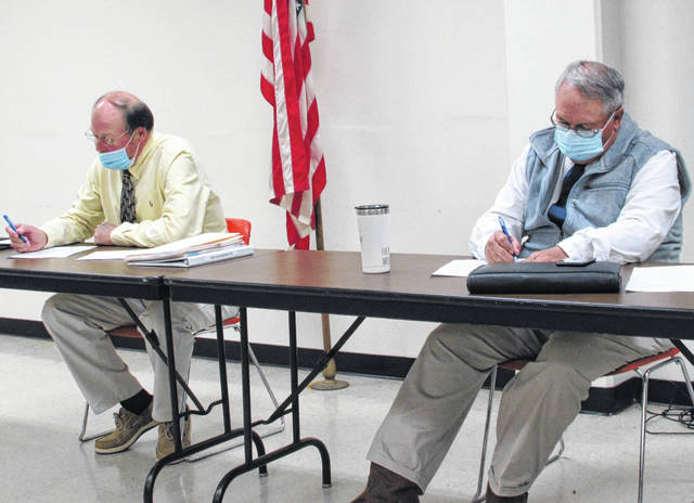 Shown, from left, are county commissioners David Daniels and Jeff Duncan during Wednesday's regular board meeting.
