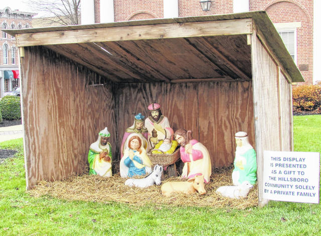 Evoking the gospels of Matthew and Luke, workers assembled the annual nativity display on the grounds of the Highland County Courthouse Friday morning.