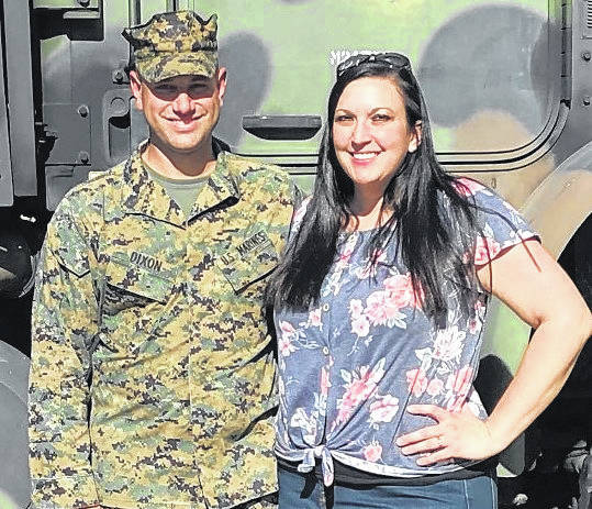U.S. Marine Corps (Res.) Gunnery Sgt. William Dixon and his wife Mary stand beside a military vehicle following Saturday's promotion ceremonies.