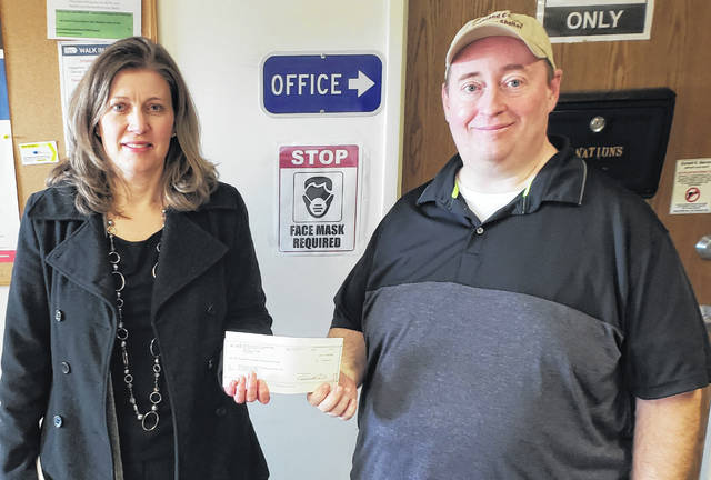 NCB recently donated $2,500 to Highland County Homeless Shelter. Pictured are NCB's Jennifer Alloy (left) and Homeless Shelter Director Greg Hawkins.