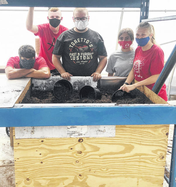 "During the 2019-20 academic school year, Mr. Pohlman's welding class created a soil bin for the Hillsboro FFA Chapter's greenhouse. The greenhouse management class was able to team up with the advanced metals class to create the new soil bin. Ever since, the soil bin has been used several times and has benefited the Hillsboro FFA Chapter's greenhouse class. The greenhouse class uses the soil mixing table multiple times throughout the year for planting and transplanting. Pohlman told Mrs. McNeal, ""I am glad we got to benefit the FFA Greenhouse with something so useful, and allow my students to use their welding skills for a school project."" Pictured (l-r) are Shane Sullivan, Lawton Parry, Nicholas Lucas, Jessica Howland and Clara Page."