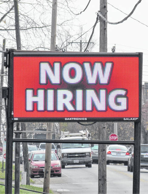 Sign like this one on North West Street in Hillsboro reflect improving job prospects for Highland County residents.