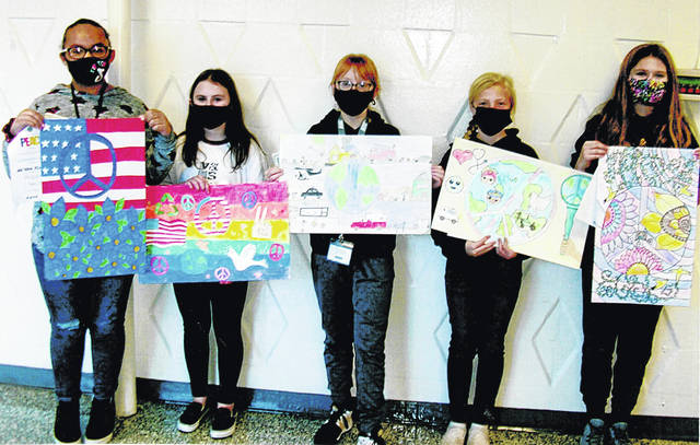 Pictured (l-r) are Na'Kaia Kinney, Taylor Minton, Caraline West, Baylee McClain and Bridgett Purdy-Wylie with their winning posters. The contest is sponsored by the Lynchburg Lions Club.
