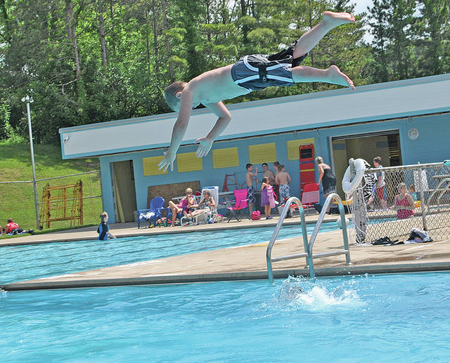 A youngster takes a dive during a past summer at the public swimming pool in Hillsboro. The new Hillsboro Swimming Organization is making plans to open the pool on Memorial Day weekend next year.