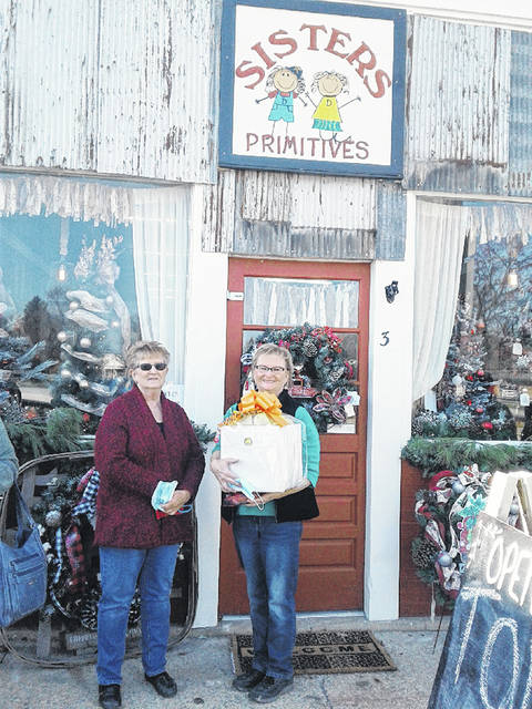 The village of Leesburg held a ribbon-cutting for Sisters Primitives on Friday, Nov. 13. The new downtown business is located at 3 S. Fairfield St. in Leesburg. For more information and hours of operation contact Sisters Primitives at 937-728-3555 or 937-725-0495. Pictured are Diane Davis (left) and Donna Smith.