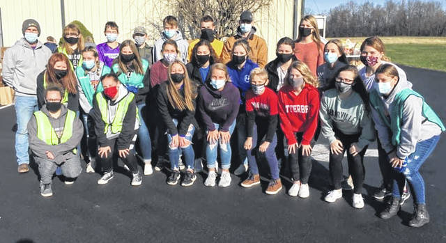 "Jim George once said, ""Serving others prepares you to lead others."" The McClain FFA had 25 members serve with the Greater Life Assembly Church on North Shore Drive and Catholic Charities of Southwestern Ohio at their monthly food pantry. The FFA members helped sort, package and load food for families to receive. They we were able to serve 200 families from the local community. The McClain FFA members are shown in front of the church building in this picture."