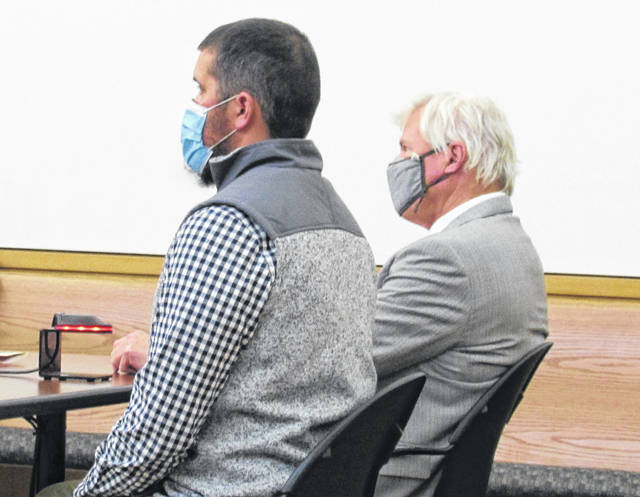 Former Leesburg Police Sergeant Roy Stephens (left) and attorney James Boulger are shown at Tuesday's pretrial hearing in Hillsboro Municipal Court.