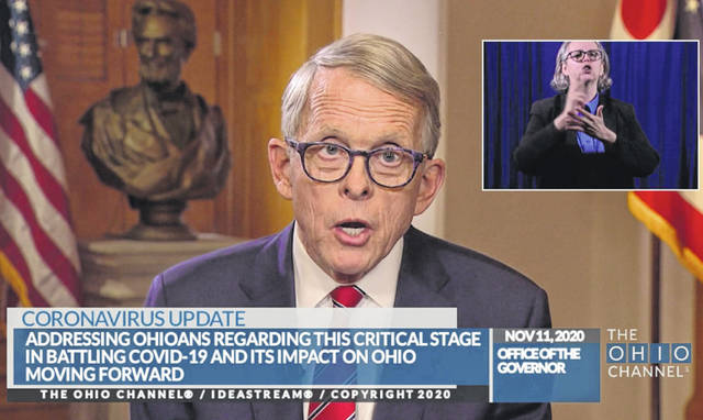 In a statewide address on Wednesday evening, Ohio Gov. Mike DeWine announces a forthcoming revised mask order and a forthcoming new social gathering order.