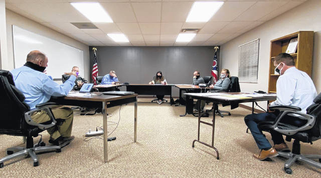 "Lynchburg-Clay Superintendent Brett Justice reveals that the school does not have a COVID-19-related ""disaster plan"" at the district's Thursday board of education meeting. Pictured, from left: treasurer Richard Hawk; board members Gary West, Brad Hess, Bobbie Jo Ernst, Bret Malone and Kristen Greenawalt; and superintendent Brett Justice."