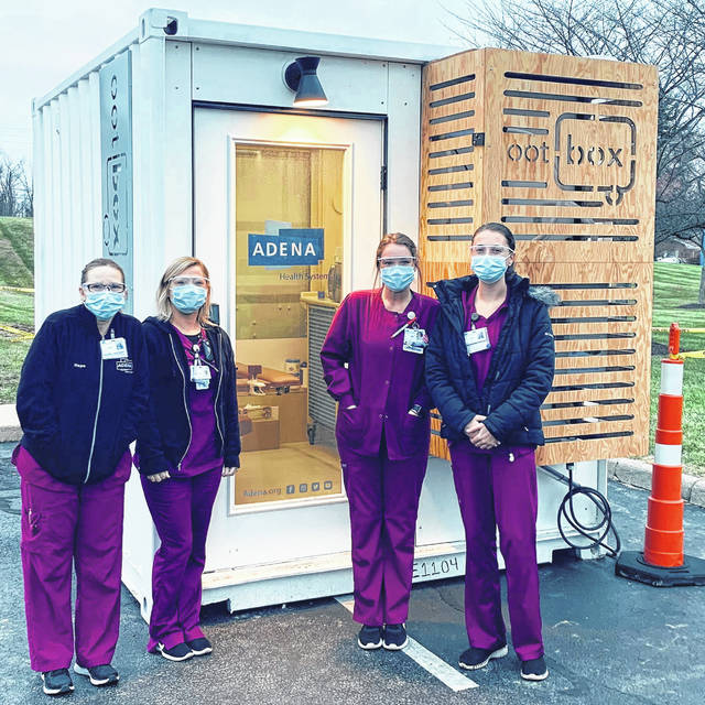 "Adena nurses are pictured in front of an ""ootBox"" that will help the hospital's urgent care locations provide curbside services."