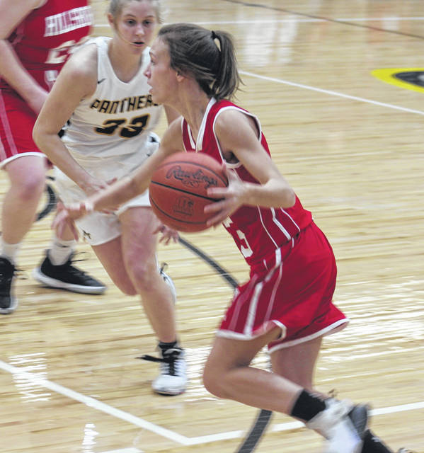 Hillsboro junior Bryanna Bledsoe dribbles down the court, guarded by Miami Trace junior Emma Pitstick.