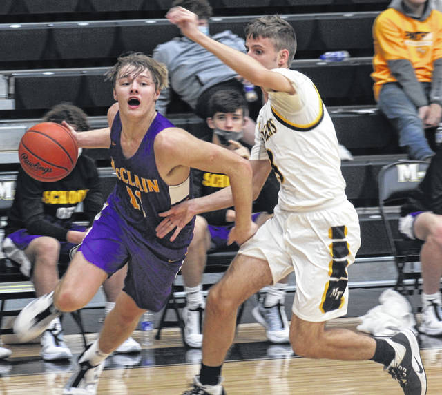 McClain junior Bryson Badgley drives on Miami Trace senior Bo Little. Badgley was the game's leading scorer with 17 points. He also had a game-high 11 rebounds.
