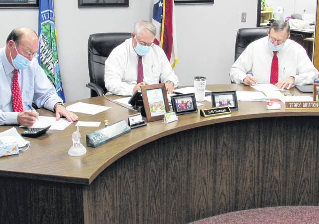 Shown from left during Wednesdays meeting of the Highland County board of commissioners are David Daniels, president Jeff Duncan and vice president Terry Britton.
