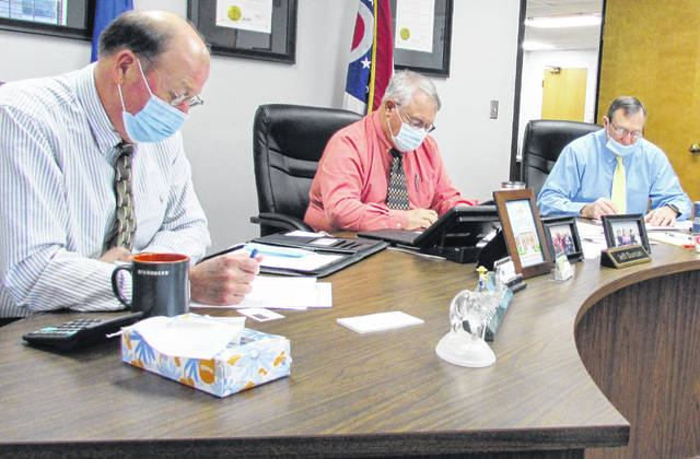 Shown (l-r) during their Wednesday meeting are Highland County commissioners David Daniels, Jeff Duncan and Terry Britton.