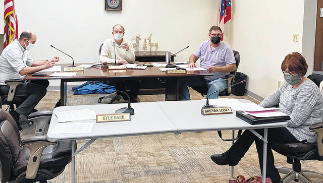 Council members (l-r) Eric Borsini, Phil Clyburn, Mark Branham and Brenda Losey are pictured during Tuesday's meeting. Kyle Barr was excused from the meeting.
