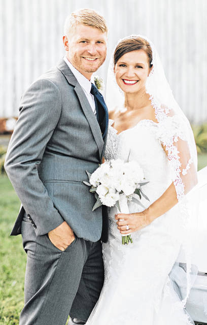 Ashley Marie and Seth Ryan Oglesby are pictured on their wedding day.