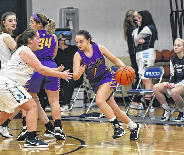 McClain Lady Tigers faced the Blanchester Ladycats on Wednesday night. McClain won the away game, 60-36. McClain point forward Liz Kegley, #34, blocks a Blanchester player while point guard Evelyn Vanzant, #1, moves the ball up the floor.