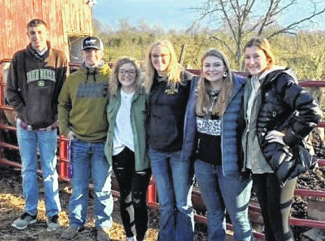 """The Mowrystown FFA will hold its annual """"Day of Giving"""" community service event on Thursday, Dec. 17. Members will create and prepare items such as tie blankets, diaper cakes, dog toys, food boxes, and Christmas cards for nursing and veterans homes. The chapter will accept donations of the following baby items, except for diapers: baby bottles, pacifiers, baby bibs, teething toys, small stuffed animals, rubber ducks, rolls of ribbon, baby socks and hats, baby powder, old tee shirts, socks, jeans, towels and blanket-making fleece fabric. They will also accept monetary donations. The chapter hopes to make 100 blankets, each taking two-yards of material. In the past, the Mowrystown FFA has made dog toys for animal shelters, blankets for Children's Hospital, cards for the nursing and veterans homes, and food bags filled with canned goods and other types of food for the students of their school. Donations can be dropped off at the front office of Whiteoak Jr./Sr. High School in Mowrystown. Pictured from left: Mowrystown FFA member Weston Blair, vice president Bobby Satterfield, member Jessie Satterfield, reporter Emmy Hawkins, president Chandra Hil, and sentinel Lydia Carr."""