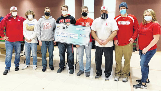 NCB recently donated $2,500 to the Hillsboro High School baseball team. These young athletes are pictured giving back to our community by helping pack and load shoe boxes for Operation Christmas Child. Pictured (l-r) are reserve coach Benn Miller, Peyton Aber, Evan Fender, Cullen Barney, Coltin Hunter, assistant varsity coach Duston Richards, varsity coach Matthew Garman and NCB's Jessica Richards.