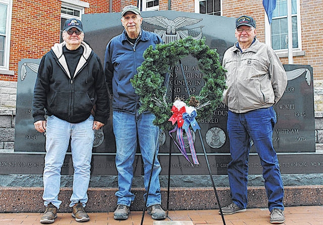 Members of Hillsboro VFW Post 9094 placed a wreath Monday at the Highland County Veterans Memorial in observance of Pearl Harbor Remembrance Day. In honor of the lives lost on Dec. 7, 1941, in the attack on Pearl Harbor, and in accordance with orders from the President of the United States of America, Ohio Governor Mike DeWine ordered that U.S. and Ohio flags be flown at half-staff upon all public buildings and grounds throughout Ohio from midnight to midnight on Dec. 7, 2020. Pictured are (l-r) VFW Senior Vice Commander Dwight Reynolds, VFW Commander Rick Wilkin and VFW Junior Vice Commander John Walker.
