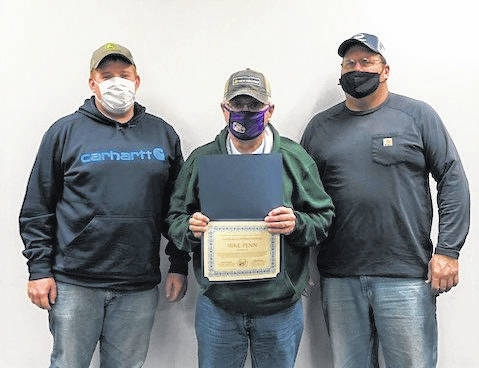 Mike Penn (center) is presented a certificate of appreciation from fellow supervisors Kyle Mustard (left) and Jim Carr (right) for his outstanding service to the Highland Soil and Water Conservation District.