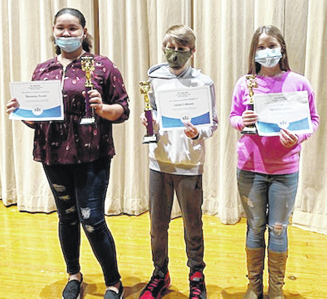 The annual Greenfield Middle School Spelling Bee was held on Nov. 23 in the McClain auditorium. Although there was no audience in attendance, there were 28 participants in grades 6-8. The first-place finisher was eighth-grader Harmony Peyatt. The second-place finisher was seventh-grader Jason Calhoun. The third-place finisher was seventh-grader Olivia Stegbauer. Pictured (l-r) are Peyatt, Calhoun and Stegbauer.