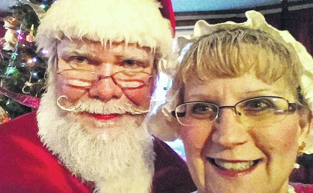 Bruce and Terri Stauffer are pictured in their familiar roles as Santa and Mrs. Claus.